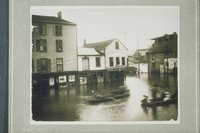 Flood of 1936:  rowboats at junction of State Street and Commerce Street, Hartford