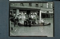 Flood of 1936: men with canoe, Temple Street, Hartford