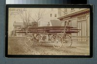 Pioneer fire wagon in front of Neptune Engine Company, Stonington