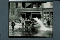 Flood of 1936:  pumping water in front of Feinberg Brothers, 562 Front Street, Hartford