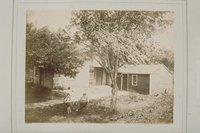Alondo Morgan and boy in front of house, Washington