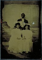 African-American man and two African-American women in white dresses, Norwich