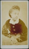 African-American woman with earrings and a velvet blouse, Norwich