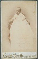 African-American baby in a christening gown, Norwich