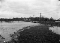 Road, bridge and river in flood, Hartford, possibly 1924