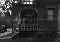 Brick house with porches, car in front, Hartford