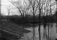 Bridge and river, possibly Park River, in flood, Hartford, possibly 1924