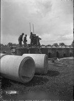 African American men and pipe sections (Maple Avenue sewer construction), Hartford, June 16, 1914