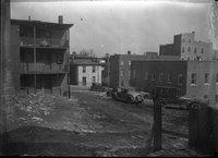 Area between buildings, cars in view, Hartford