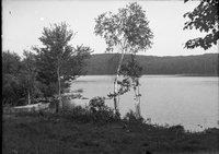 Body of water and boat, annual outing 1920