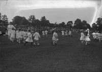 Boys and girls moving in circle (dancing), Hartford park