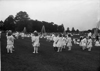 Boys and girls standing in pairs, Hartford park