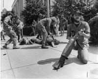 Anti-Vietnam War demonstrators, mock battle, Federal building, Hartford, August 7, 1971