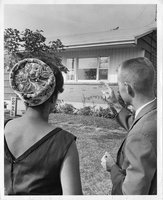 African American woman  looking  at home to purchase, Hartford, 1963