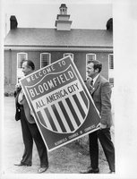 Bloomfield  Chamber of Commerce President  Raymond McMahon, & Mayor Edward J. Stockton with greeting sign, 1971