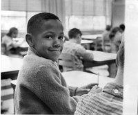 African American boy in suburban classroom