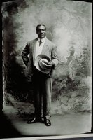 African American man holding hat