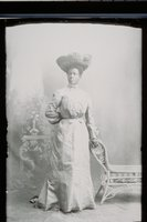 African American woman in hat with feather trim