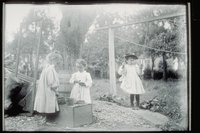 Ada Newbury of Mystic and two other girls playing in a yard