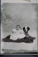 Baby and dog (James N. Elliott)
