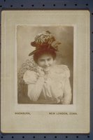 Young woman in a plumed hat