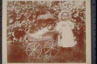 Ada Newbury, with a wicker doll carriage