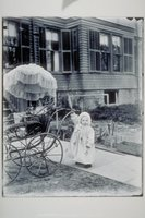 Ada Newbury and wicker baby carriage, Willow Street, Mystic