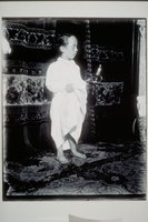 Ada Newbury of Mystic in a nightgown, holding a candle