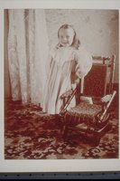 Ada Newbury of Mystic standing by a chair