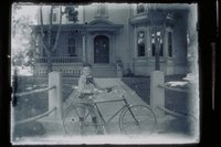 Boy with bicycle in front of Christopher Morgan House, East Main Street and Broadway, Mystic