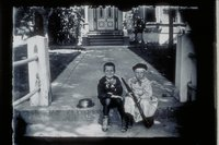 Two boys with toy rifle in front of Christopher Morgan House, East Main Street and Broadway, Mystic