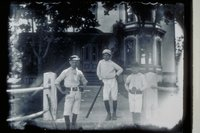 Three boys in baseball uniforms in front of Christopher Morgan House, East Main Street and Broadway, Mystic