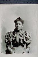 African American woman in plaid shirtwaist (Johnson)