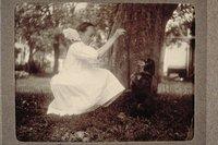 Ada Newbury playing with her dog June