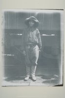 African American woman in pants standing next to a train