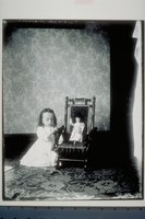 Ada Newbury of Mystic with doll in child's chair