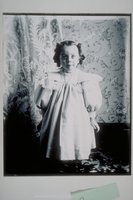 Ada Newbury of Mystic in front of a lace curtain