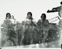 Aivilik Inuit women on deck with infant, Hudson Bay, Canada