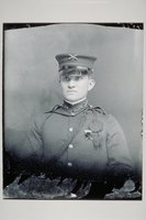 Young man in military uniform and cap