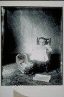 Ada Newbury of Mystic reading a newspaper