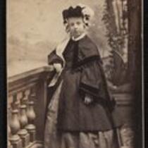 Photograph: Frances (Frannie) Thompson as a girl, wearing a cloak