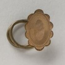 Physical object: Cufflink belonging to Charles S. Stratton
