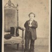 Photograph: Charles S. Stratton beside high backed chair