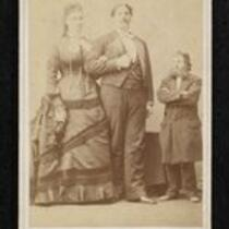Photograph: Captain Bates and his wife, with another man for scale